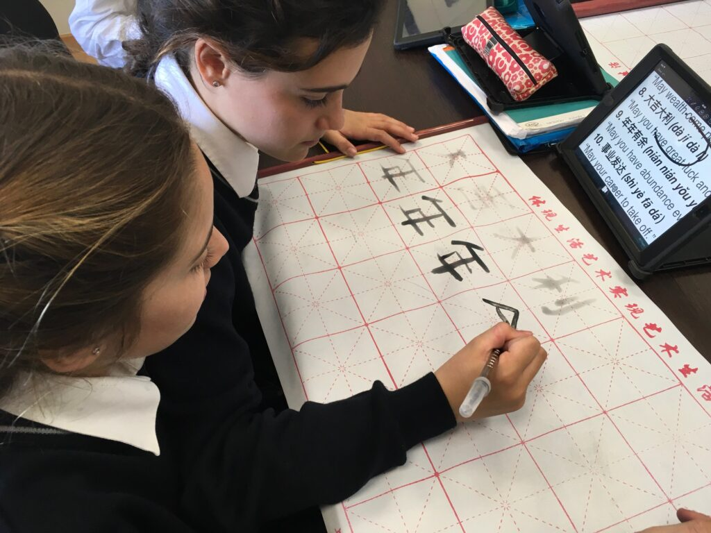 3Practising Chinese calligraphy